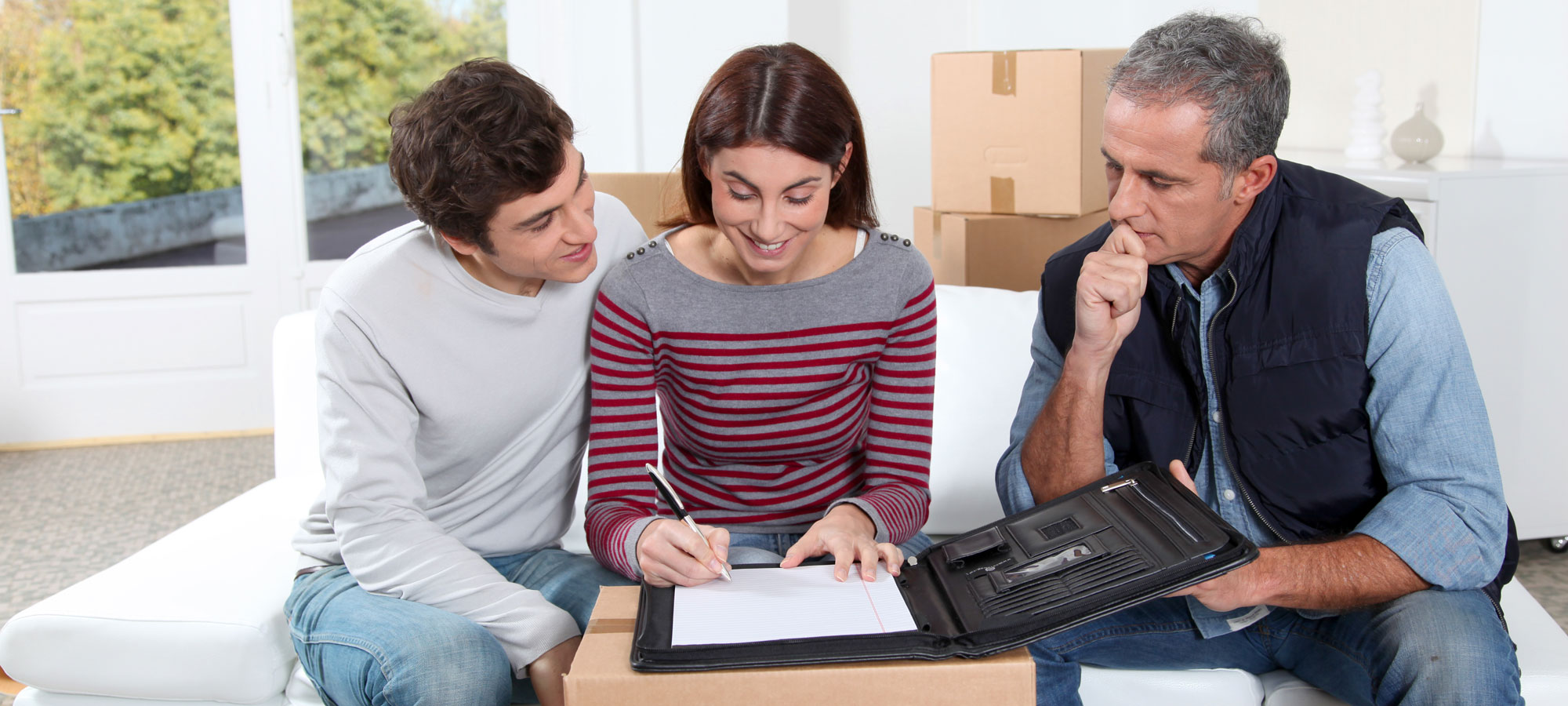 Couple-Signing-Moving-Contract